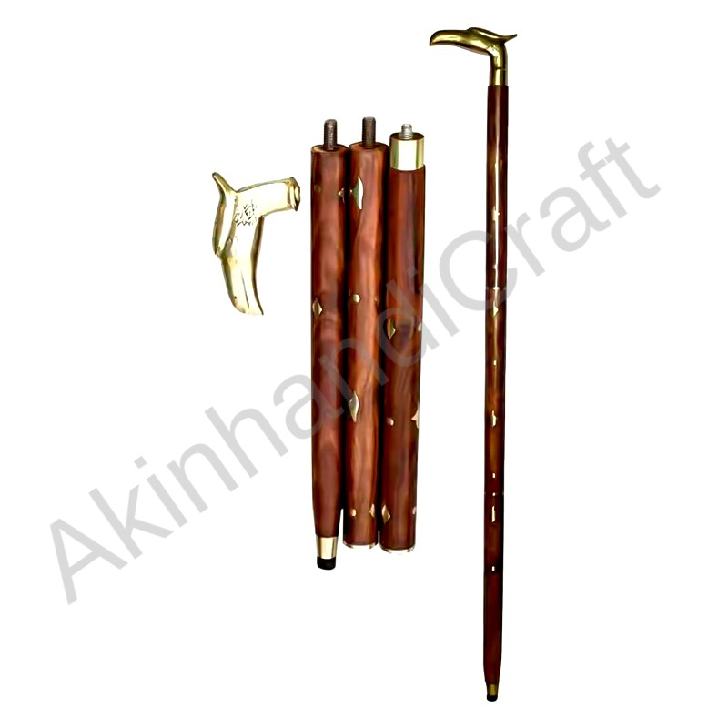 wooden stick with brass handle